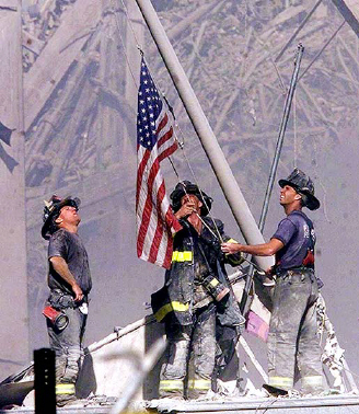 fire-fighters-raise-american-flag-in-front-of-world-trade-center-ruins2
